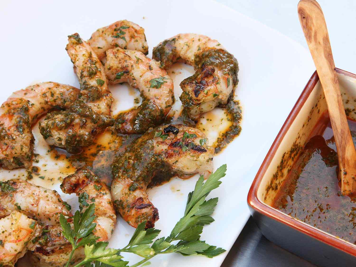 Overhead view of grilled shrimp with chermoula