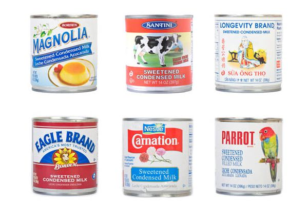 Six assorted cans of sweetened condensed milk.