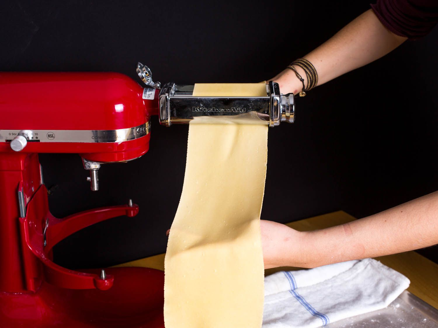 A sheet of fresh pasta being rolled out.