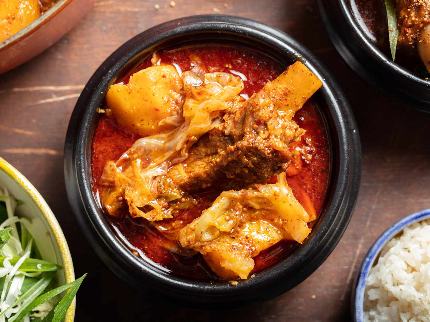 Bowl of gamja-tang with garnishes.