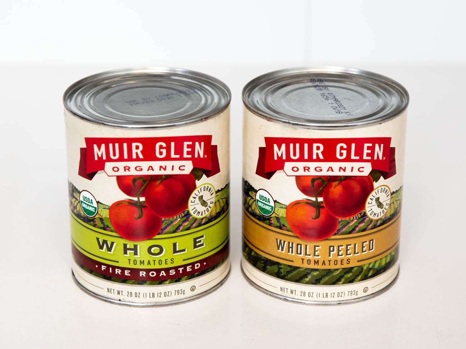 Side by side comparison of canned fire-roasted whole tomatoes and plain canned whole tomatoes